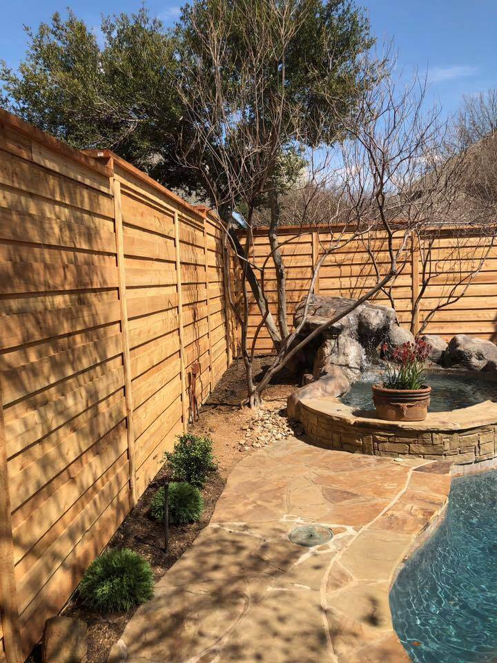 fence and patio around pool