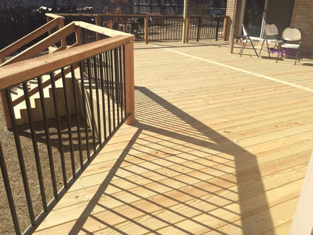 deck with railing and stairs