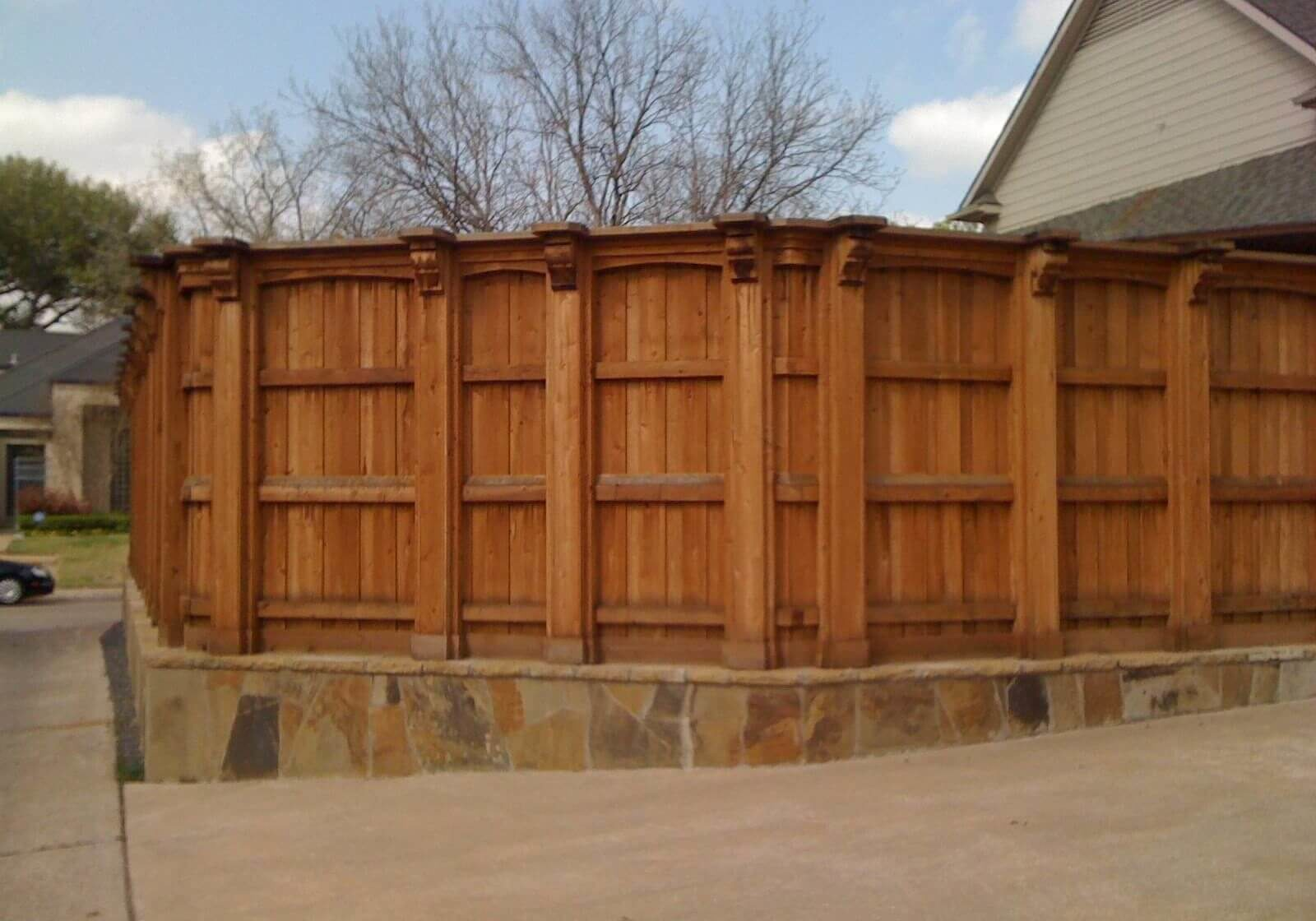 cedar fence and stone wall